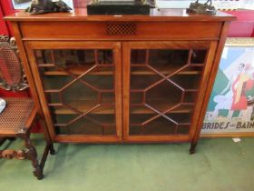 An Edwardian crossbanded and inlaid mahogany two astragal glazed door bookcase with height