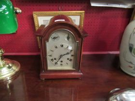 A mahogany cased Westminster chime mantel clock with key and pendulum,