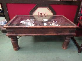 An Eastern hardwood coffee table with glass top display,
