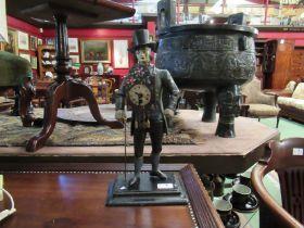 A reproduction cast figural clock,