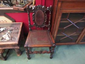 A pair of Charles II revival oak bergère chairs with carved coronet and turned decoration