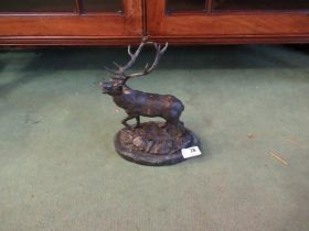 A bronzed figure of a stag on naturalistic base,