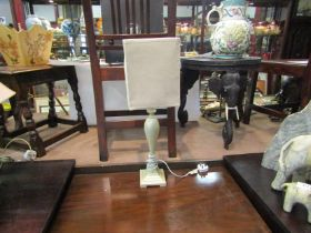 A cream table lamp and shade