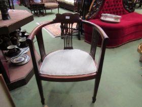 An Edwardian mahogany elbow chair the bow shape back with pierced splats having quatrefoil