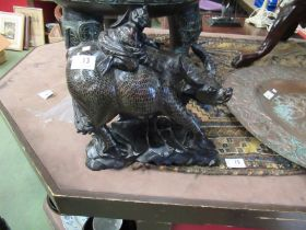 A pair of 19th Century Chinese silver inlaid carved hardwood water buffalo carrying baby buddhas,