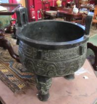 A large Chinese bronze censor on tripod feet, script to interior,