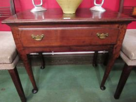 A circa 1760 pegged oak lowboy the single frieze drawer over pad foot straight cabriole legs,
