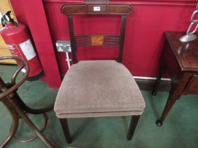 A pair of George III carved mahogany chairs with inlaid panelled pierced back rests on square