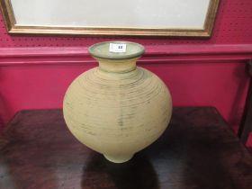 A yellow matte glass vase.