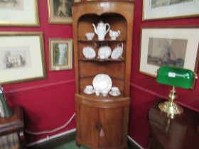 A George III stripped pine bow front corner cupboard,
