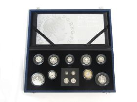 """A cased Royal Mint silver proof coin set """"The Queen's 80th Birthday Collection"""" includng £5, £2, £1,"""