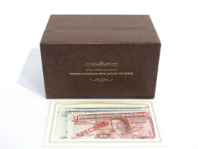 A box containing the official presentation sets of specimen banknotes from around the world,