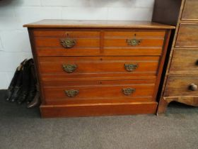 A Circa 1900 satin walnut chest of two short over two long drawers, plinth base.