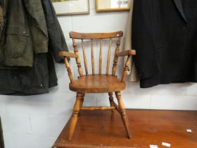 An early 20th Century childs windsor stickback chair,