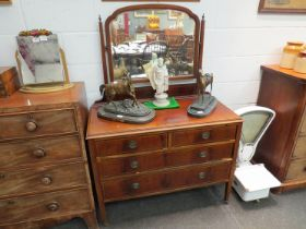 A 1930's walnut dressing chest, the mirror back over two short and two long drawers,