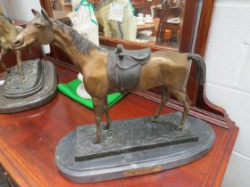 A cold cast bronze model of horse with side saddle by J Moigniez on marble stand, signature to base,