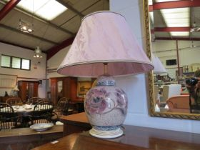A table lamp in the style of a ginger jar,