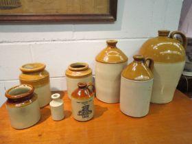 Four stoneware flagons,