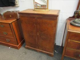 A burr walnut musical cabinet with sectional interior,