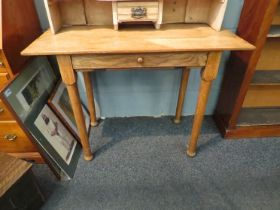A light oak side table with frieze fall flap revealing sectional interior together with a pine