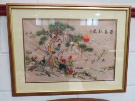 A Chinese silk embroidery of birds, framed and glazed,
