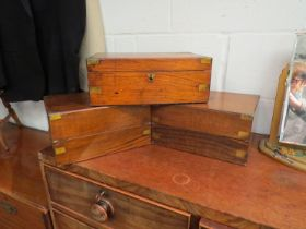 A Victorian walnut writing box with brass mounts and tooled leather slope