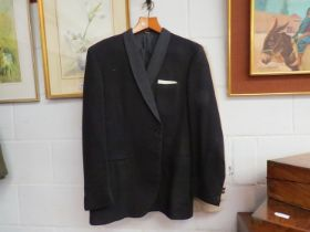 A Daks gentleman's evening jacket and trousers and an Austin Reed cream gentleman's single breasted