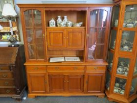 A modern oak dresser with glazed cupboards above drawer and cupboard base, 186cm tall,