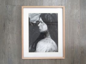 FRANCES MARTIN (Contemporary Norwich artist): A framed and glazed charcoal on paper portrait of a