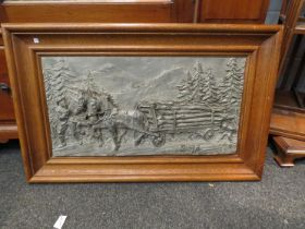 A resin relief picture depicting a man horses with timber wagon, signed Felix,