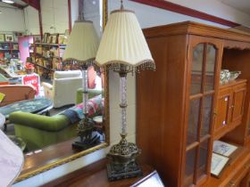 An Oriental bronze and marble based lamp 87cm tall