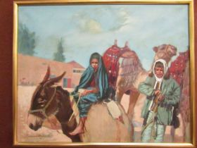 A 20th Century oil on canvas, middle Eastern School, woman riding a donkey with man leading a camel.