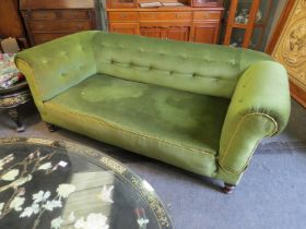 A Victorian drop-end sofa with green buttoned velour upholstery,
