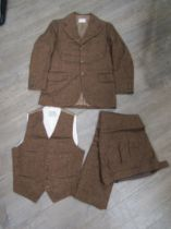 A three piece wool suit made for Sir John Mills by Bermans & Nathans costumes,
