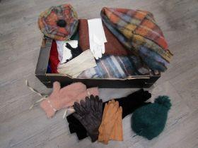 A box containing mohair scarves,