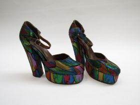 A pair of original 1970's sparkly fabric platform shoes in neon colours