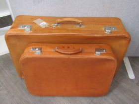 Two tan coloured pig skin suitcases of graduated size, purchased from Harrods circa 1940's,