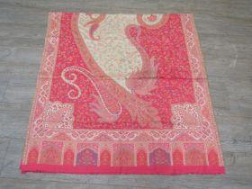 A large paisley shawl,