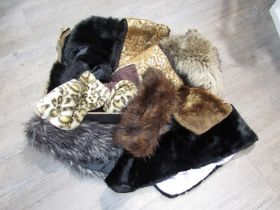 A box containing fur items including stoles,