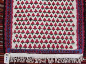 A Kelim runner black ground with geometric design in pink and green