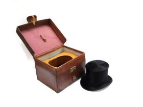 A black top hat by makers Woodrow,