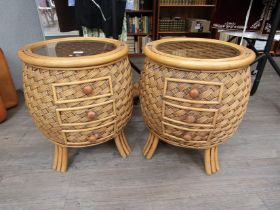 A pair of bamboo and rattan kitsch style conservatory/bedroom circular tables with smoked glass