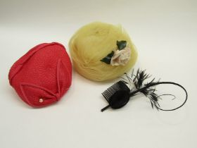 A box containing 1950's lemon net hat with pink rose, vintage pink straw skull cap,