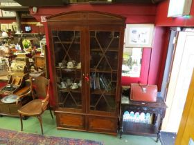 A 19th Century mahogany astragal glazed two door bookcase on two door cupboard base with adjustable