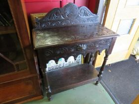 A 19th Century carved oak side table with green man design to drawer on pot cupboard under tier,