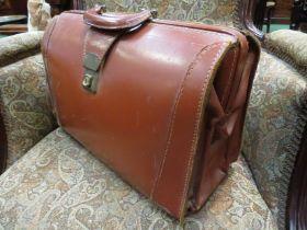 A vintage cow hide doctors bag