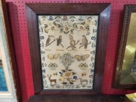 An early 19th Century sampler decorated with birds and animals with floral border Hannah Prince?