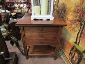 A circa 1920 walnut two tier work table of three drawers on square tapering reeded legs (inlaid