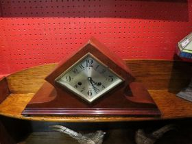 An Art Deco mantel clock, diamond shaped silvered dial,