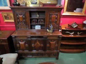 An 18th Century oak and walnut veneer court cupboard with linen fold side panels,